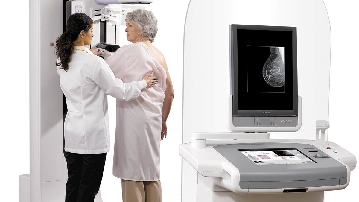 3D Mammography, Selenia Dimensions System being used to screen a patient