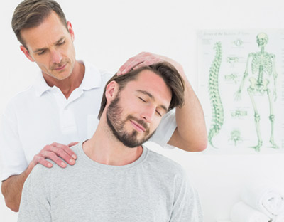 Patient receiving a chiropractic adjustment for pain