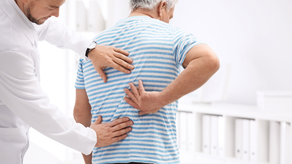 A chiropractor examines a patient