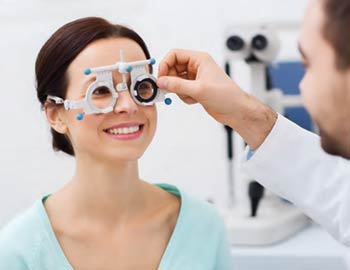 A woman getting an eye exam.