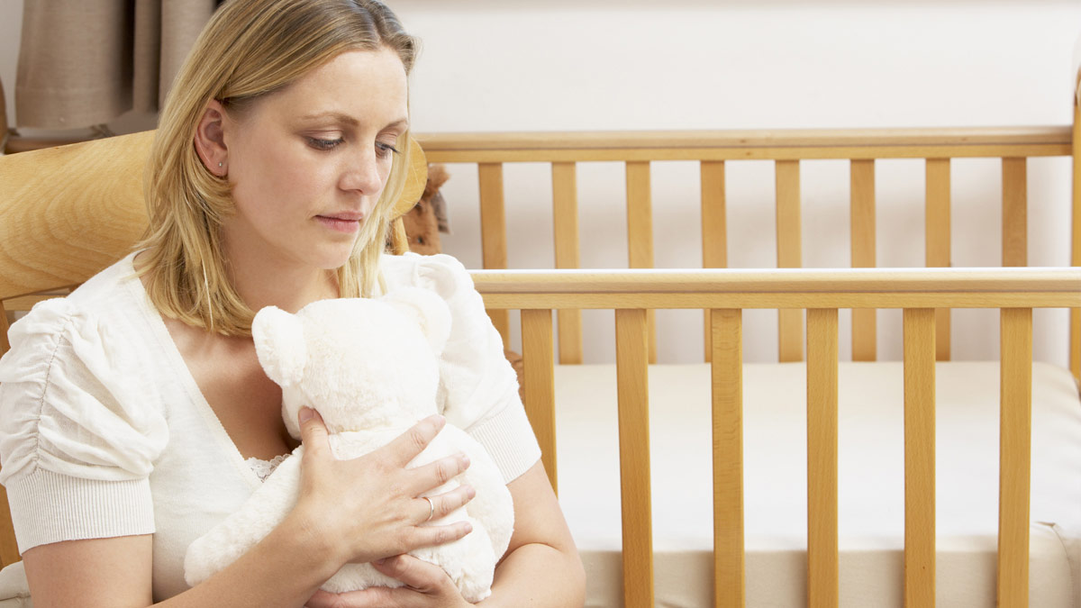 A grieving woman after miscarriage.