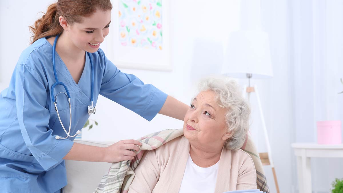 An elderly woman recives and a caring homecare professional