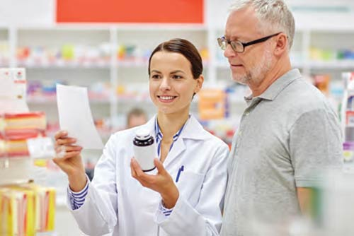 a pharmacist answering a patient's questions