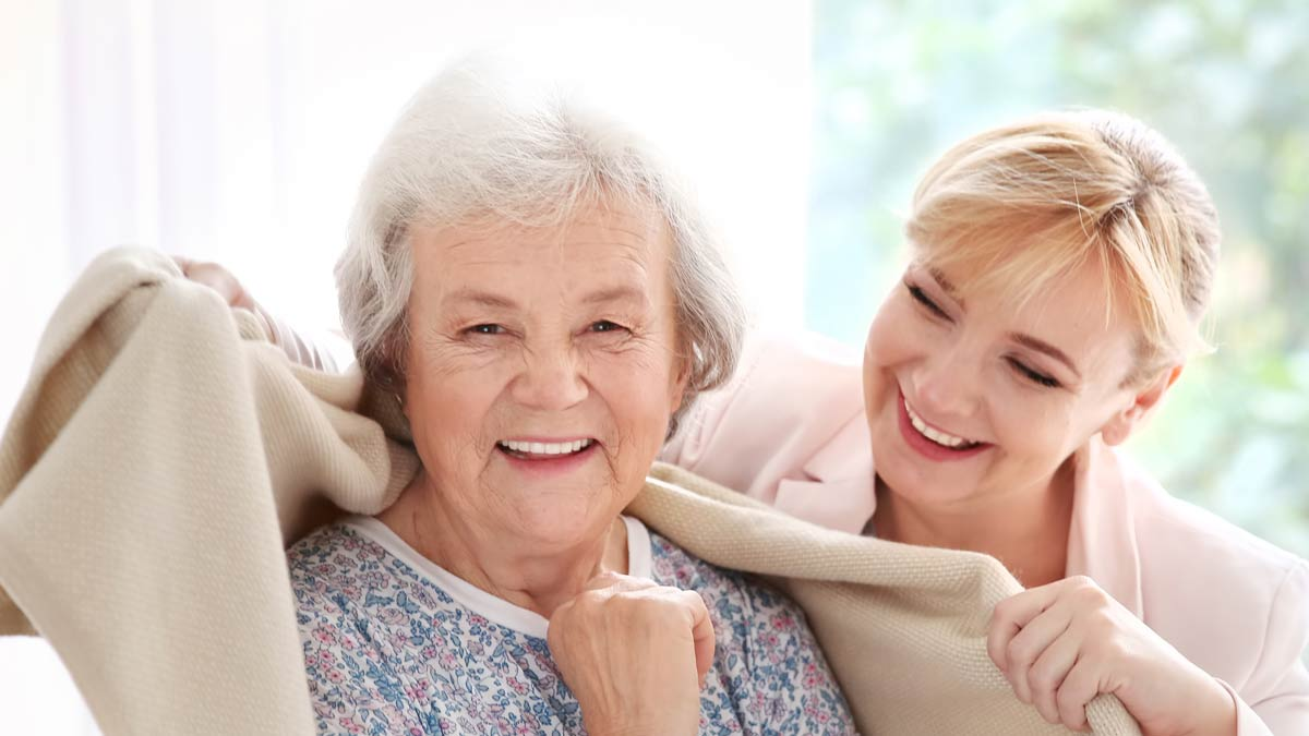 A happy elderly woman enjoys in home care