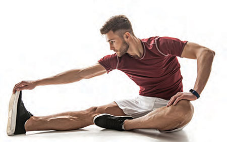 A man doing a seated calf stretch before exercise
