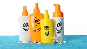 -Plastic bottles of sunscreen with smiles-