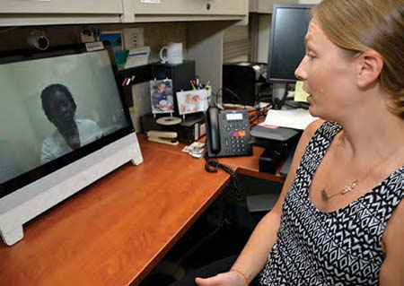 Anna Birks, PsyD, director of the Charleston Telemental Health Hub, uses telemedicine to talk with a veteran. Photo by James Arrowood.