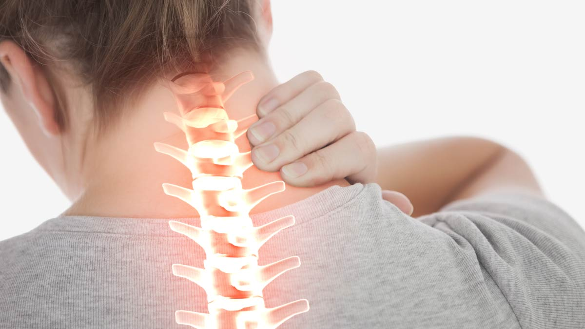 Woman with neck pain. Blame your back for that pain in the neck.