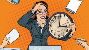 Chronic Stress Effects the Body. Image: A woman shows signs of stress due to demands on her time.