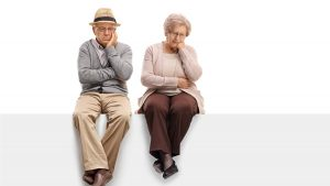 A depressed-looking older couple.