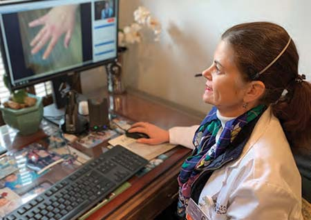 Dr. Kay Durst treats a patient using telemedicine at East Cooper Medical Center.
