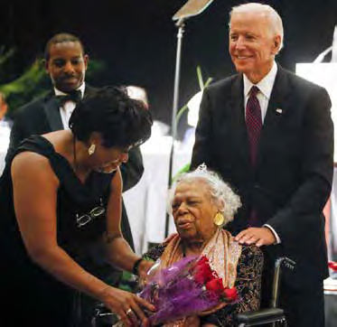 Dot Scott, president of the Charleston NAACP branch, talks with Earsie Jackson and former Vice President Joe Biden.