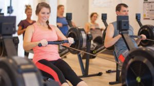 Mount Pleasant woman using a rowing machine for a full body workout
