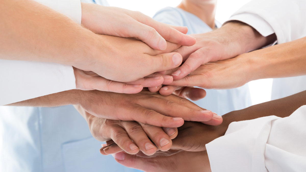 Non-medical team members join hands