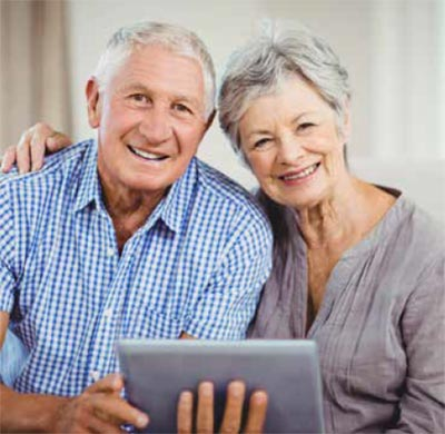 Preserving precious memories: an elderly couple with a computer tablet