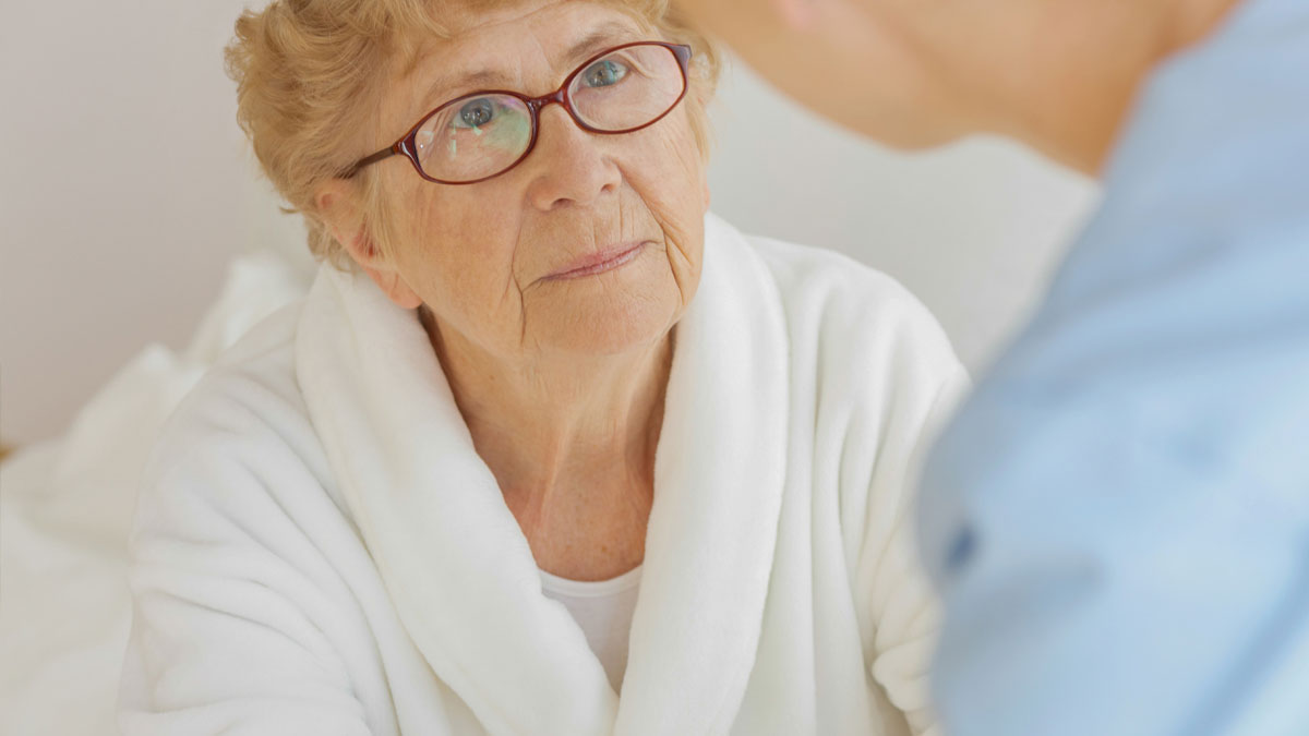 An Alzheimer's patient with her care provider.