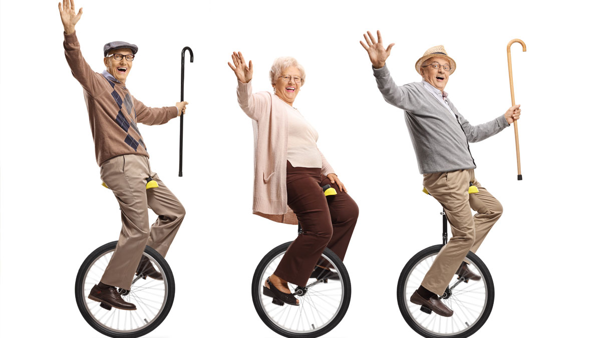 Keeping Your Balance. Photo of seniors on unicycles.