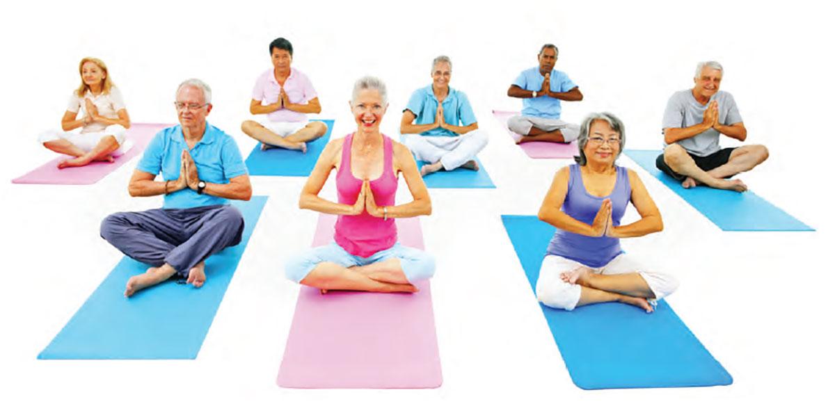 Seniors taking a yoga class