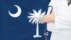 A doctor and the South Carolina state flag