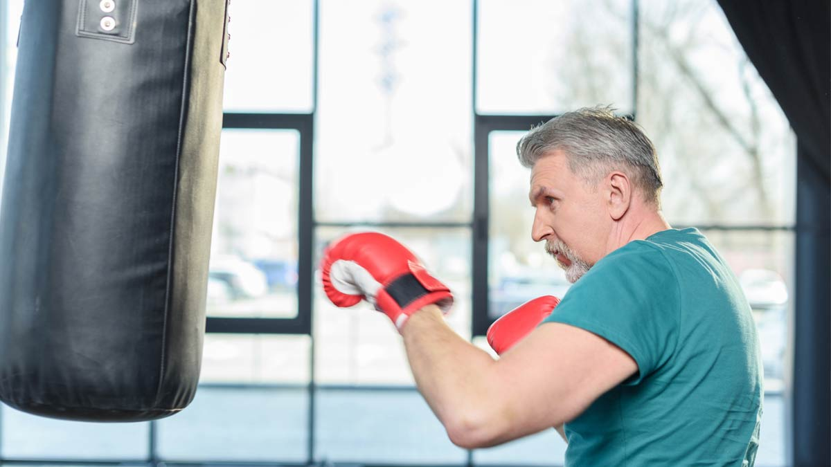 An older man following an exercise routine to keep mind and body sharp.