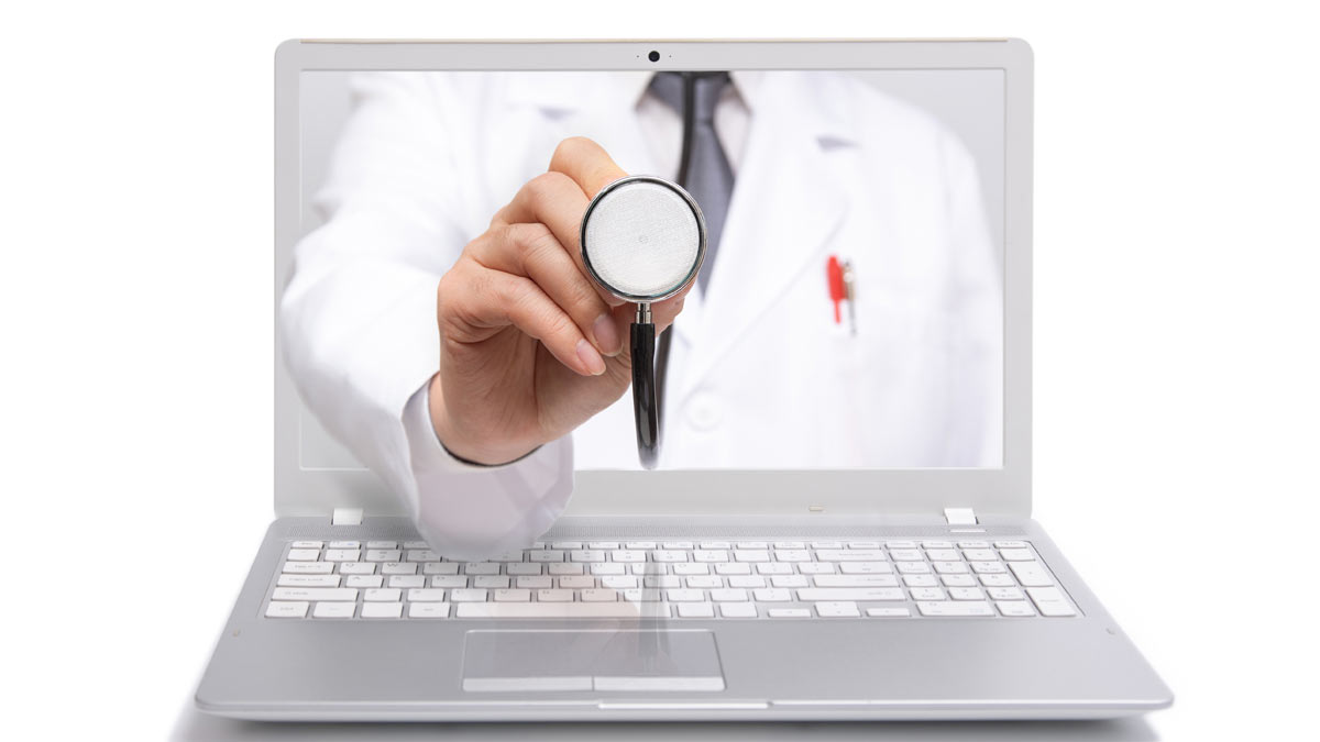 TELEHEALTH: Image of a doctor reaching through a laptop's video screen