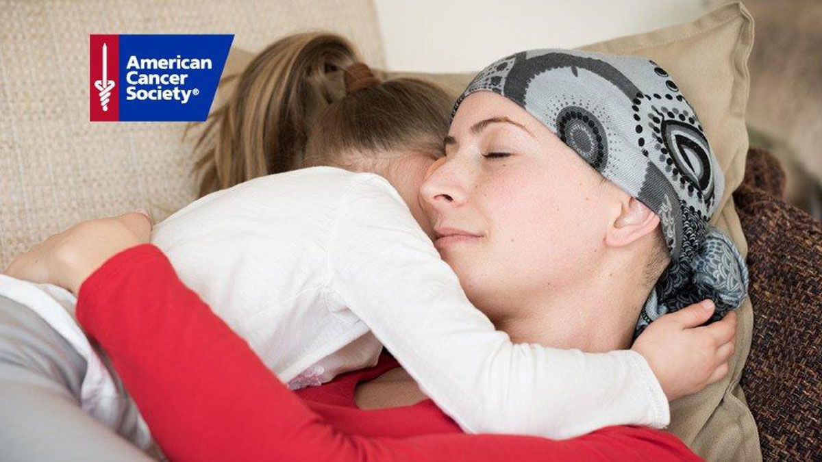 Woman hugging little girl, cancer patient, American Cancer Society