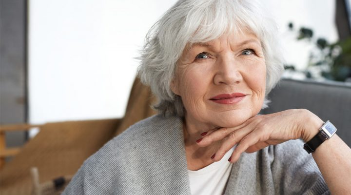 A woman thinking about hear health.
