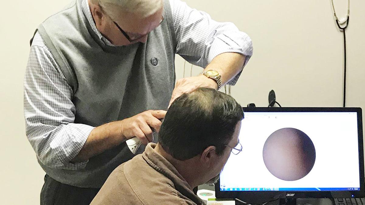 A patient gets a hearing evaluation for hearing aids.