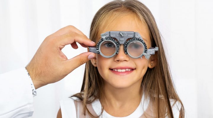 A young girl getting an eye exam