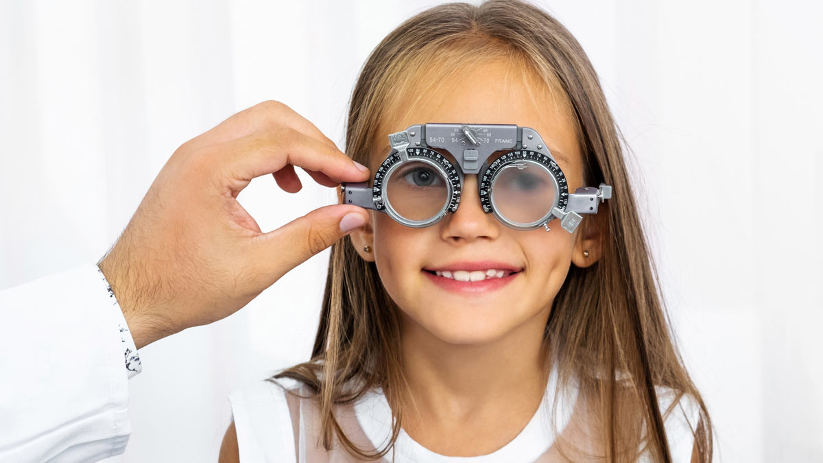 A young girl getting an eye exam
