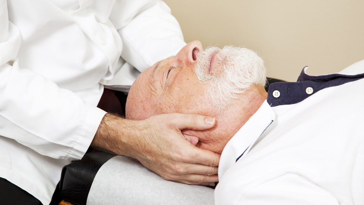 A man receiving a chiropractic adjustment