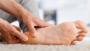 A doctor examines a patient's foot