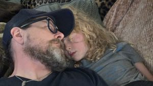 Asher, who was given a diagnosis of autism several years ago, relaxes with dad.