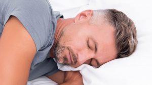 A man gets a good night's sleep.
