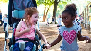 Two students at the South Carolina School for the Deaf and the Blind smile as they enjoy an afternoon outside.