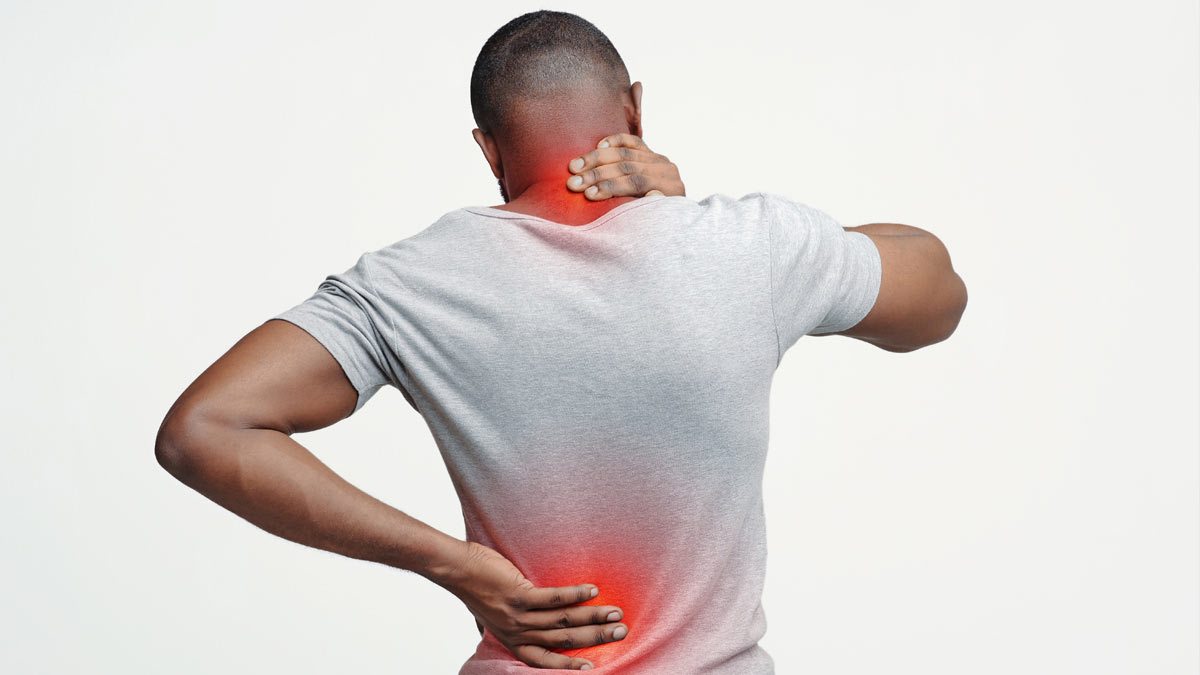 Illustration: A man with back and neck pain.