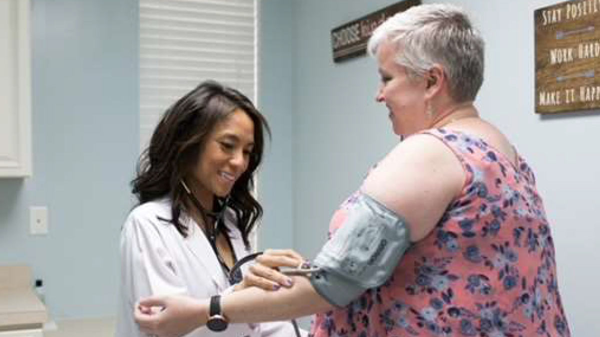 Justine DeCastro, M.D., of Palmetto Proactive Healthcare in Mount Pleasant with a patient
