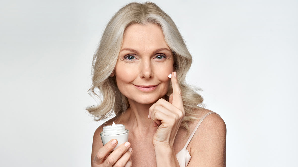 A woman with skin cream to prevent wrinkles.
