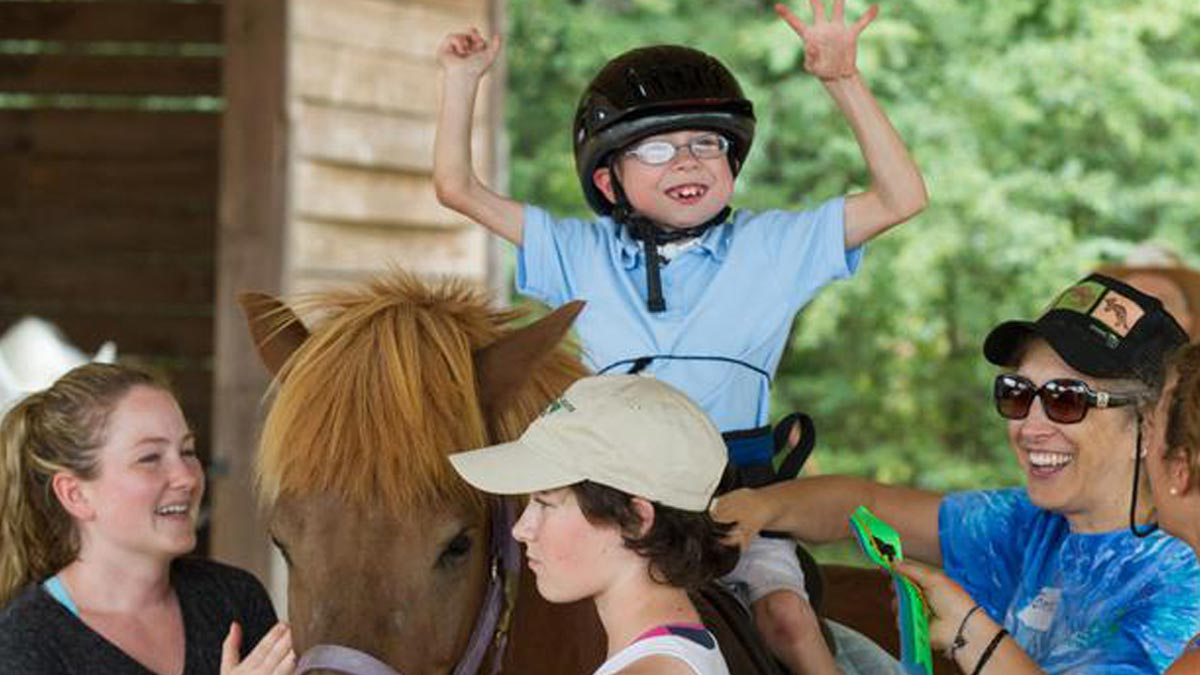 Photo for Resources for Disabled Children and Adults article. A young boy on a horse at Horse 'N' Around in Lancaster, SC.
