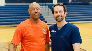 Jerome Stewart, a Timberland High School physical education teacher and basketball coach with Dr. Ben Schell, orthopedic spine surgeon, South Carolina Sports Medicine & Orthopedic Center.