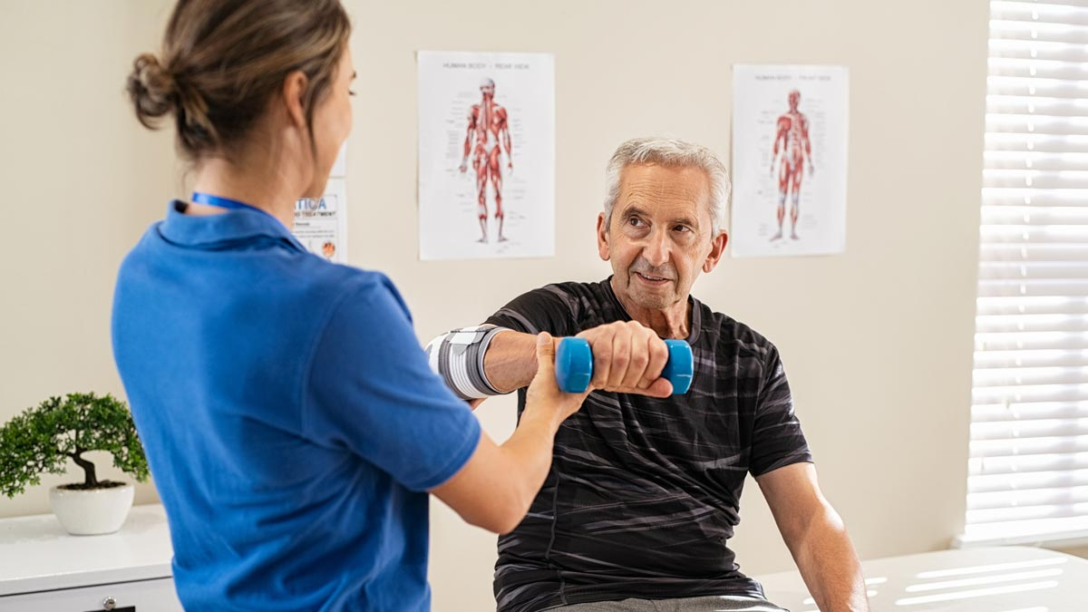 Photo: A Physical Therapist doing arm exercises in rehab with a patient.